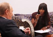 Путин даёт интервью супермодели Наоми Кэмпбелл во время Международного форума по сохранению тигра на Земле в Санкт-Петербурге