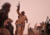 Ливийские боевики во время перестрелки