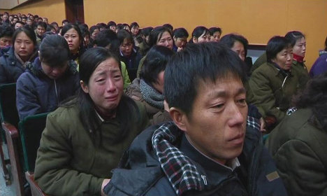 Рабочие северокорейского завода скорбят о смерти Ким Чен Ира в Пхеньяне
