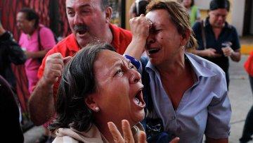 Сторонники президента Венесуэлы Уго Чавеса скорбят в связи с его кончиной