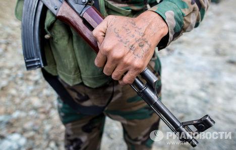 Татуировка на руке солдата сирийской армии