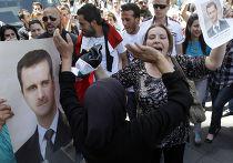 Митинг сторонников Башара Асада после объявления о его участии в президентских выборах в июне