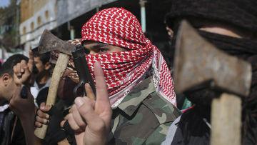 Палестинцы празднуют нападение на синагогу в Иерусалиме