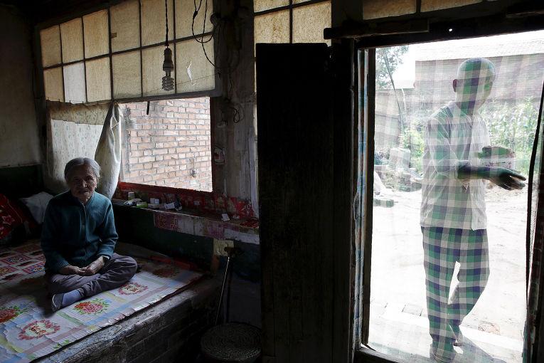 Чжан Сяньту в своем доме в городе Сиянь, провинция Шанси