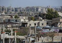 Разрушенные здания в городе Маадамия в пригороде Дамаска
