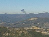 Дым над местом падения российского самолета, сбитого над турецко-сирийской границей