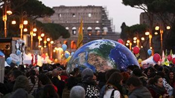 Акция протеста в Риме накануне открытия климатического саммита в Париже