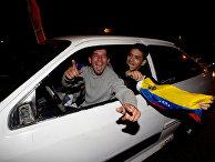 Сторонники оппозиции празднуют результаты выборов в Каракасе