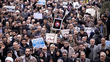 Протестующие против казни шиитского шейха Нимера Бахра Альнимера в Тегеране