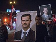 Плакат с изображением президента Сирии Башара Асада на одной из улиц Дамаска