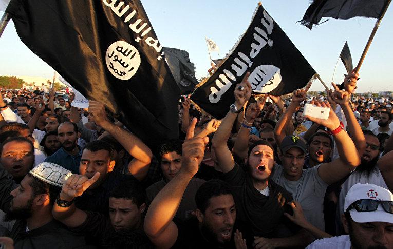 Сторонники группировки Ансар Аль-Шариа на демонстрации в Бенгази протестуют против карикатур на пророка Мухаммеда