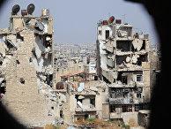 Вид на Алеппо со стороны пригорода, контролируемого правительственными войсками