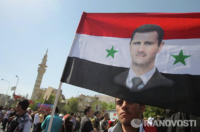 Митинг гражданских активистов в поддержку президента Сирии Башара Асада в центре Дамаска