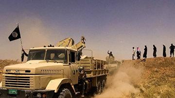 Боевики террористической группировки «Исламское государство» на границе Сирии и Ирака