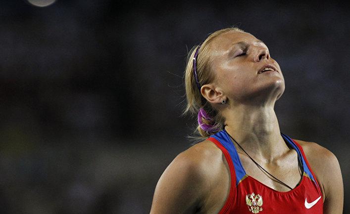 Юлия Русанова после победы в беге на дистанции 800 метров в полуфинале на Чемпионате Мира по легкой атлетике