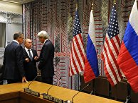 Президент России Владимир Путин, министр иностранных дел РФ Сергей Лавров и госсекретарь США Джон Керри беседуют после встречи с президентом США Бараком Обамой в рамках 70-й сессии Генеральной Ассамблеи ООН в Нью-Йорке