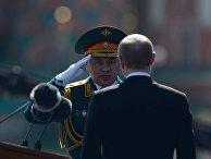 Президент России Владимир Путин и министр обороны РФ Сергей Шойгу на военном параде в честь 71-й годовщины Победы в Великой Отечественной войне на Красной площади в Москве