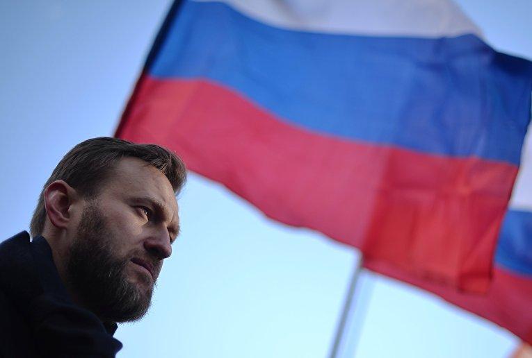Политик Алексей Навальный во время марша памяти, посвященного годовщине гибели политика, общественного деятеля Бориса Немцова