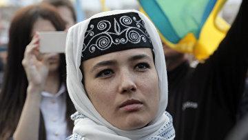Крымские татары на акции памяти в центре Киева, посвященной 72-й годовщине депортации