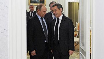 Президент РФ Владимир Путин и бывший президент Франции Николя Саркози