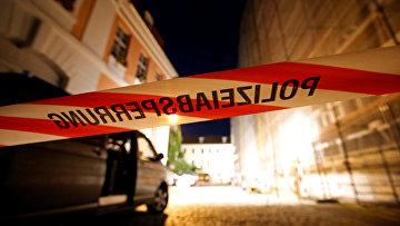 Сотрудники правоохранительных органов на месте взрыва в немецком городе Ансбахе