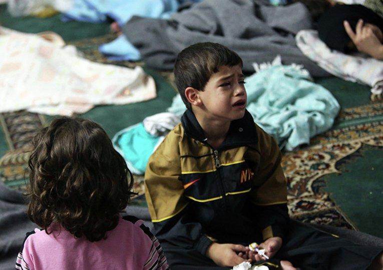 Мальчик в мечети Дамаска после химической атаки