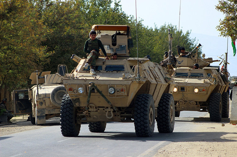 Афганские силы безопасности во время продолжающихся боевых действий с боевиками «Талибана» в Кундузе
