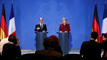 Канцлер Германии Ангела Меркель и президент Франции Франсуа Олланд на пресс-конференции