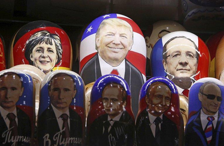 Матрешки с портретами Дональда Трампа, Владимира Путина, Ангелы Меркель и Франсуа Олландом