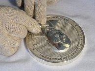 Изготовление коллекционной медальной монеты с изображением президента РФ Владимира Путина