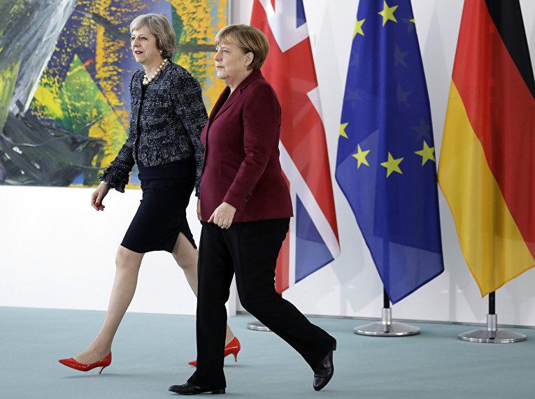 Канцлер Германии Ангела Меркель и премьер-министр Великобритании Тереза Мэй