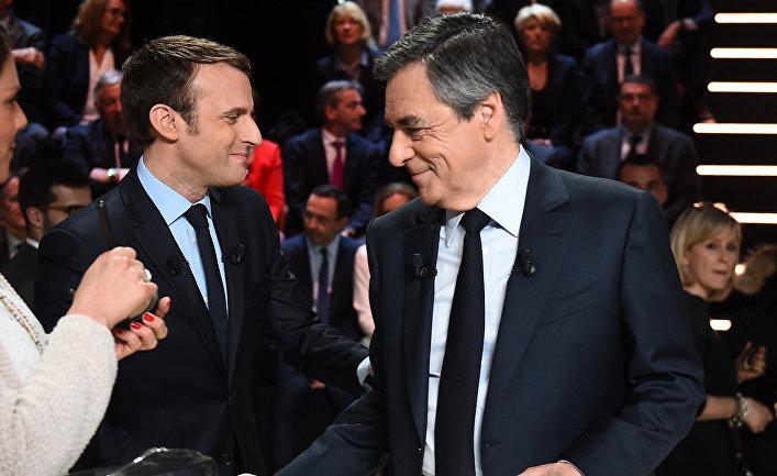 Кандидаты в президенты Франции Эммануэль Макрон и Франсуа Фийон на дебатах