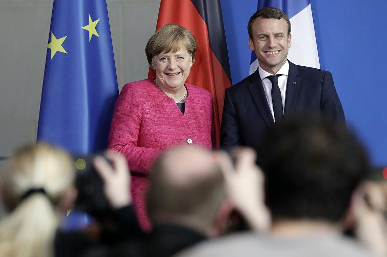 Канцлер Германии Ангела Меркель и президент Франции Эммануэль Макрон в Берлине