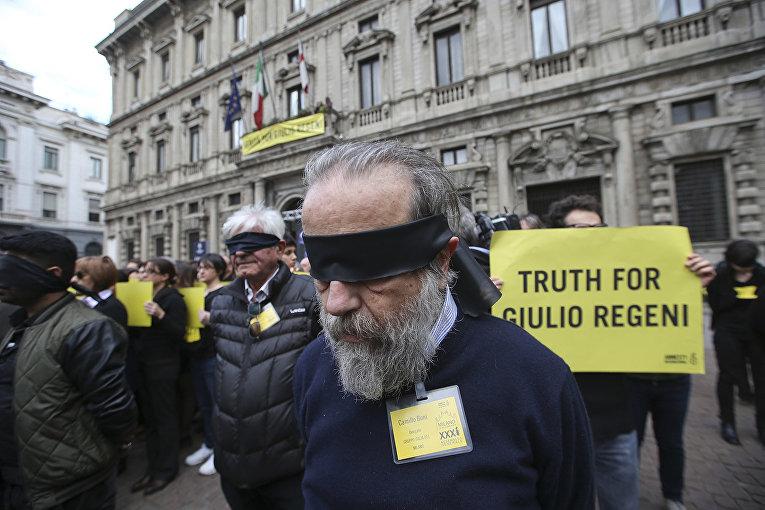 кция активистов организации «Международная амнистия» за правду о гибели итальянского студента Гвидо Регени в Милане