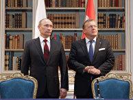 Премьер-министр России Владимир Путин и премьер-министр Дании Ларс Лёкке Расмуссен во всемя переговоров в Копенгагене