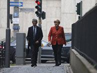 Ангела Меркель с мужем направлется на избирательный участок. 24 сентября 2017
