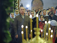 Президент России Владимир Путин во время Рождественского богослужения