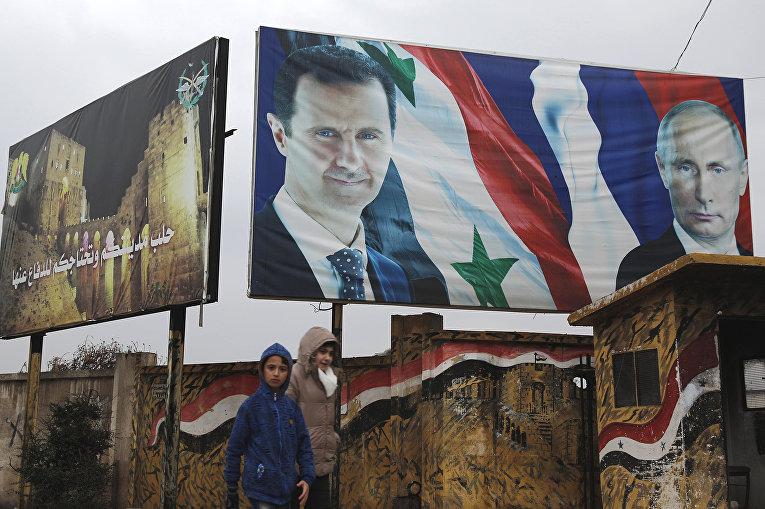 Плакаты президента Сирии Башара Асада и президента России Владимира Путина в Алеппо