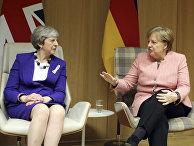 Премьер-министр Великобритании Тереза Мэй и канцлер Германии Ангела Меркель на саммите ЕС в Брюсселе. 23 марта 2018