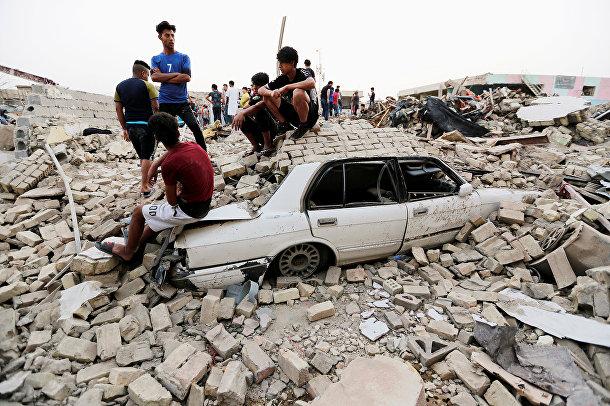 Последствия взрыва в багдадском районе Садр-Сити, Ирак