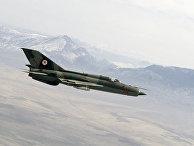 Афганские истребители советского производства МиГ-21 в воздухе в районе действия банд душманов в провинции Балх
