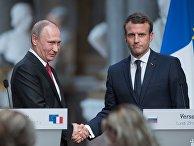 Владимир Путин и Эммануэль Макрон во время совместной пресс-конференции по итогам российско-французских переговоров в Версальском дворце. 29 мая 2017