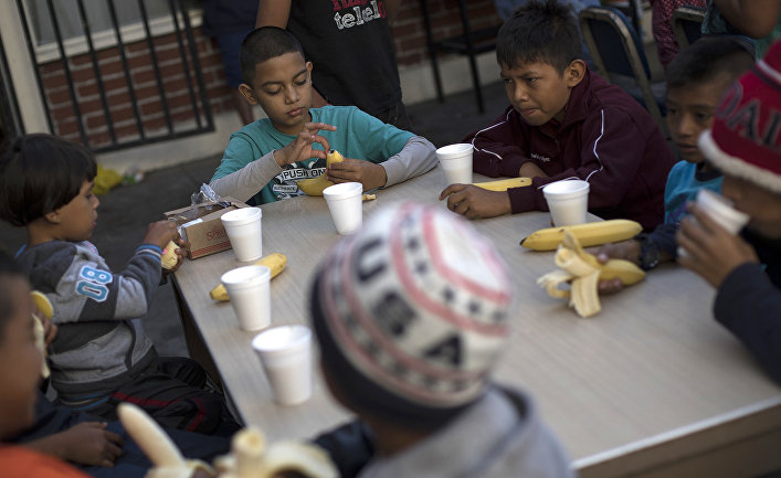 Мигранты из Гаити на границе Мексики и США в Тихуане
