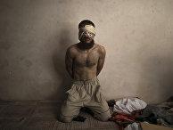 Предполагаемый боевик ИГ в городе Мосула, Ирак