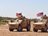Американские военнослужащие в районе населенного пункта Манбидж, Сирия. 28 июля 2018