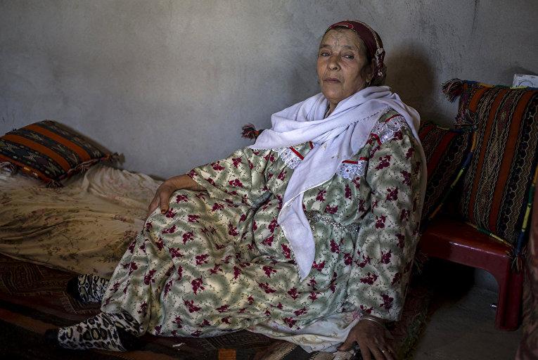 Хамса Хугали, берберка из Алжира с татуировкой на лице
