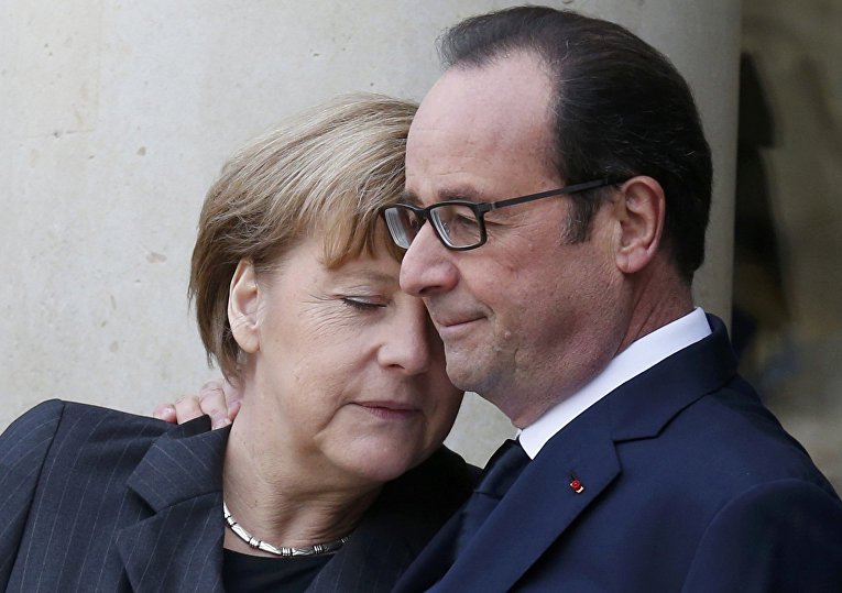 Канцлер ФРГ Ангела Меркель и президент Франции Франсуа Олланд на марше единства в Париже