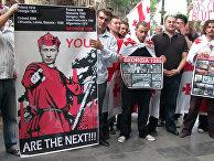 Многотысячный митинг «Стоп Россия!» вподдержку грузинской армии, ведущей бои вЮжной Осетии «заединство Грузии», наплощади Революции Роз вцентре Тбилиси, 10августа 2008 года