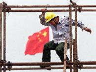 Рабочий на стройке в Пекине