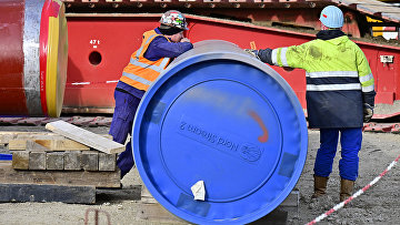 Рабочие на строительной площадке газопровода «Северный поток - 2» в немецком Лубмине